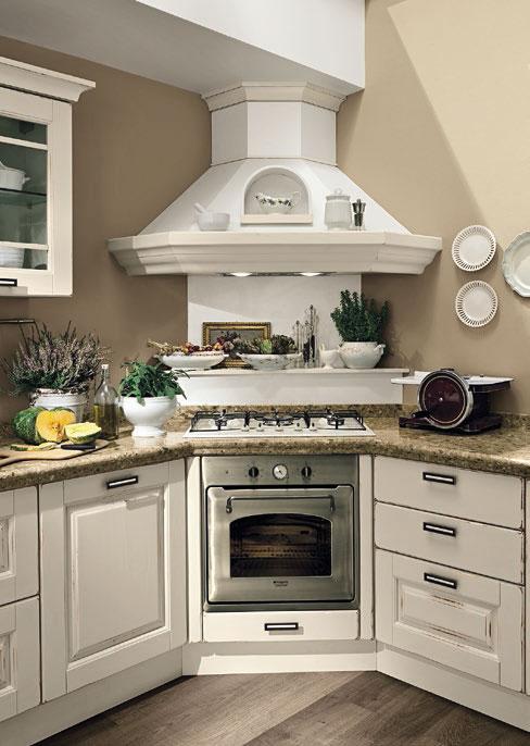 Угловая вытяжка в интерьере кухни
